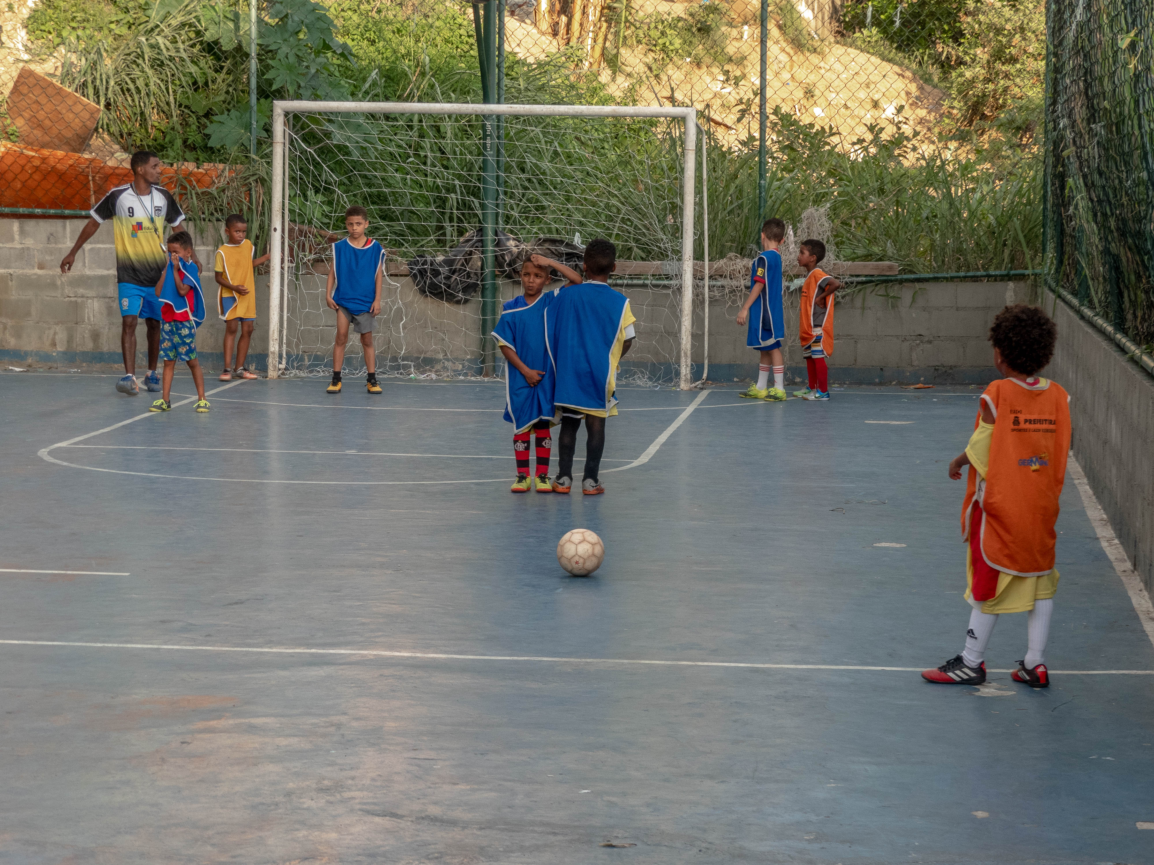 Student on EduMais's Education-Based Football Program gets ready to take a free kick on the pitch in Cantagalo