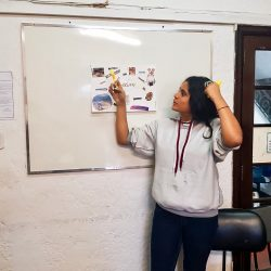 EduMais entrepreneurship program student in Rio de Janeiro's favelas presents her passions board