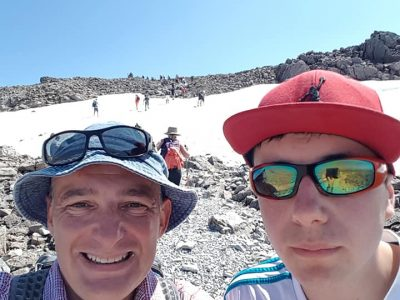 Two man with hats and glasses on at Ben Nevis Scotland