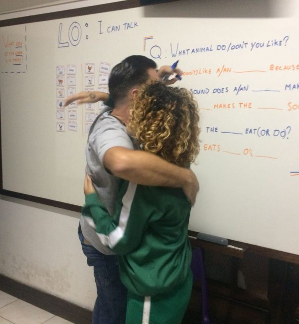 EduMais volunteer English teacher Daan receives a warm hug from one of his students in the classroom