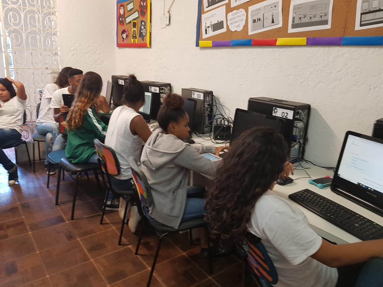 EduMais students work on their web design and computer skills in the IT room of Solar Meninos de Luz school