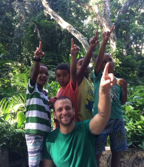 The four boys on our after-school program and volunteer Gabriele point to a monkey in the trees in Parque Lage Rio de Janeiro