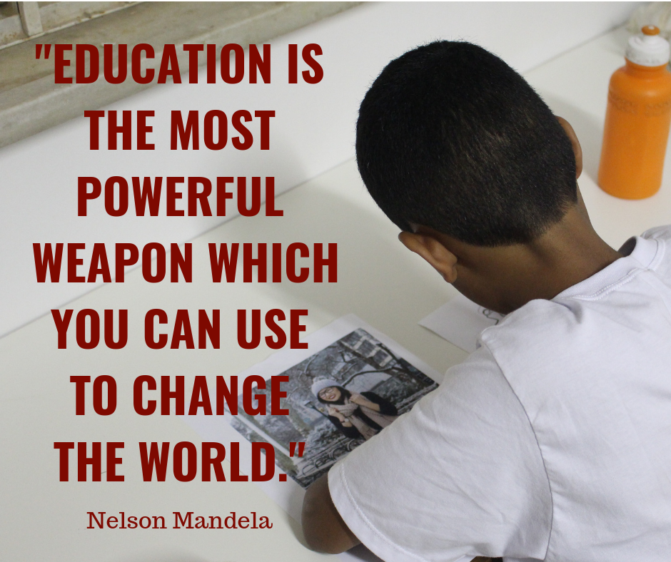 EduMais student studying in classroom with Nelson Mandela quote about Education being the most powerful weapon to change the world overlaid