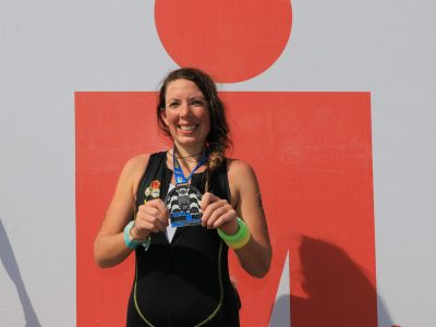 EduMais volunteer Anna Bowman showing her IronMan medal