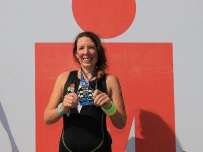 EduMais volunteer Anna Bowman showing her IronMan medal