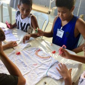 Kids-designing-their-t-shirt-summer-camp-favela-rio-de-janeiro