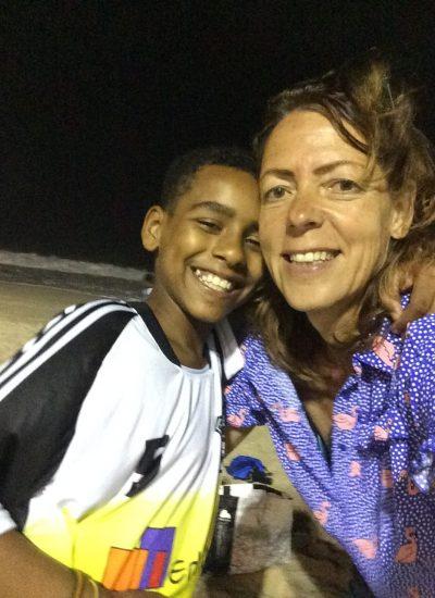 EduMais founder Diana Nijboer selfie on the beach with football program student at night