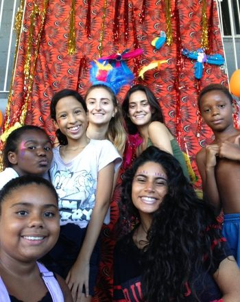 Six of EduMais's Summer Camp participants and one of their volunteer teachers looking happy