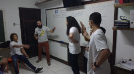 One EduMais students attempts to guess the verb charade another team are performing in EduMais's extracurricular English class