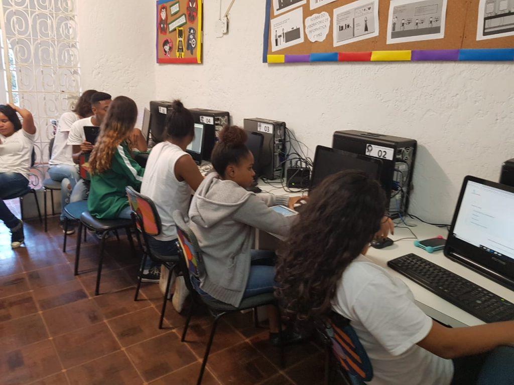 EduMais students work on their web design and computer skills in the IT room of Solar Meninos de Luz school
