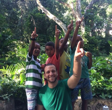 The four boys on our after-school program and volunteer Gabriele point to a monkey in the trees in Parque Lage, Rio de Janeiro