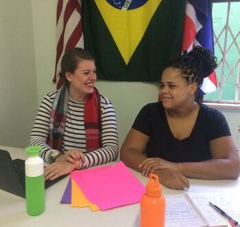 EduMais office support volunteers Iris and Adrienne working together