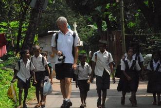 EduMais founder Diana Nijboer's husband Gerard walking with a group of children