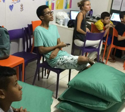 Students on EduMais's Programming Summer Camp in our classroom with their volunteer teachers Roger and Audrey